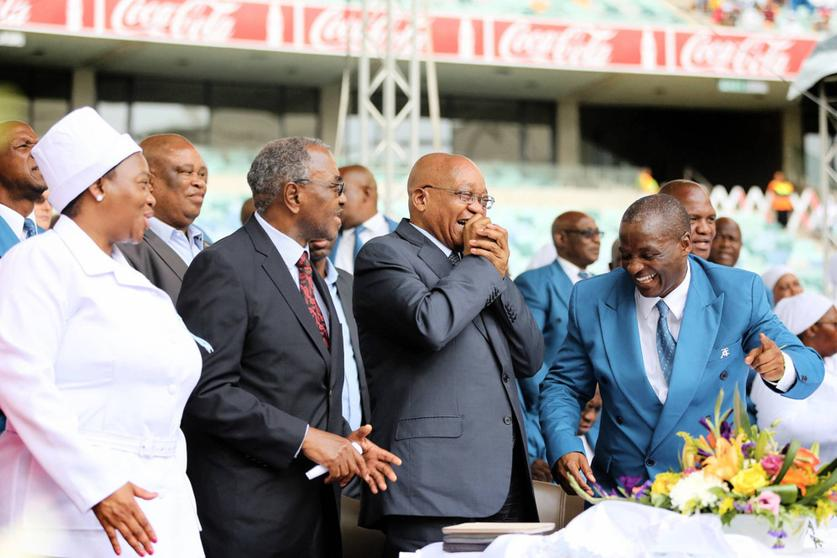 MEC for Co-operative Governance Nomusa Dube-Ncube and KZN Premier Willies Mchunu look on as President Jacob Zuma and TACC president and Chief Apostle, Professor Caesar Nongqunga, share a joke at the Twelve Apostle Church in Christ International thanksgiving day celebration.Picture: Motshwari Mofokeng/The Mercury